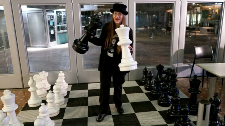 Quirky Author Lori R. Lopez Plays Chess at 54th San Diego Local Authors Exhibit